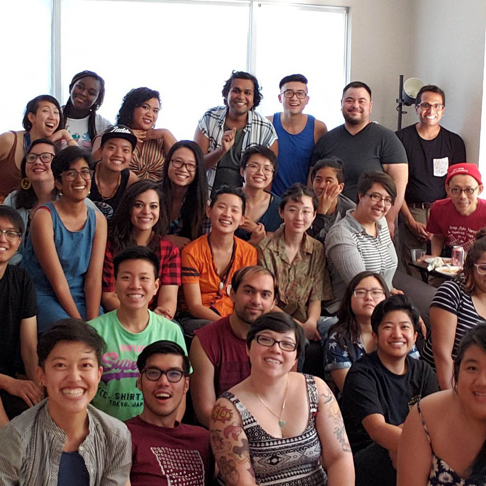 Smiling potluck group photo