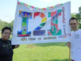 2 people holding i2i banner